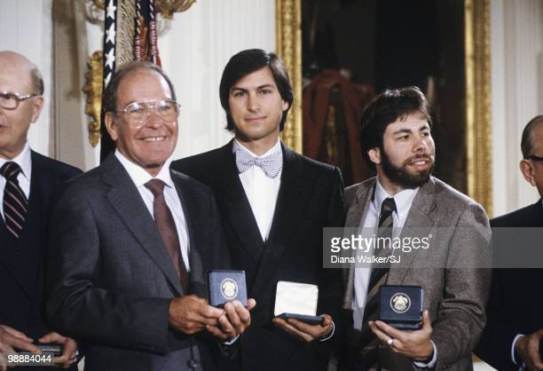 Apple Computer cofounders Steve Jobs and Steve Wozniak at the White House after receiving the National Medal of Technology from President Reagan on...