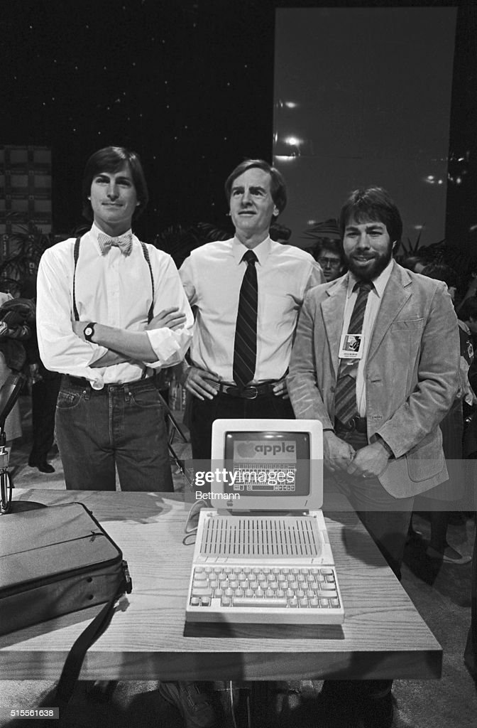 Apple Computer triggered the second blast of its two-barrel 1984 attack on the personal computing market with the introduction of a new portable computer. Apple President <a gi-track='captionPersonalityLinkClicked' href=/galleries/search?phrase=John+Sculley&family=editorial&specificpeople=265237 ng-click='$event.stopPropagation()'>John Sculley</a>, flanked by co-founders of Apple, Steve Jobs (left) and Steve Wozniak (right), unveiled the new briefcase-size Apple IIc to more than 3,000 dealers and software sector representatives at Moscone Center. Apple expects two out of three buyers to use the IIc in the home, with the rest of the sales split between schools and business.