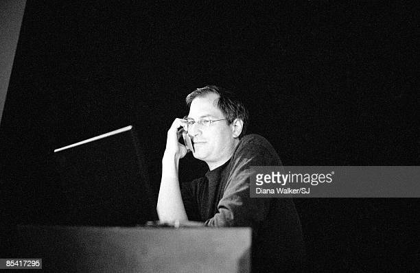 Apple Computer's CEO Steve Jobs on the phone with Bill Gates during the Macworld Expo in Boston MA August 8 1997
