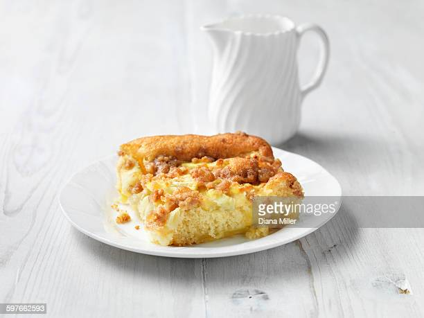 Apple crumble and custard cake, white washed wood