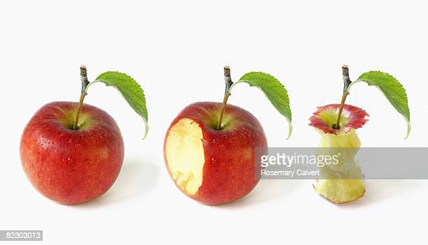 apple depicted in three stages of being eaten