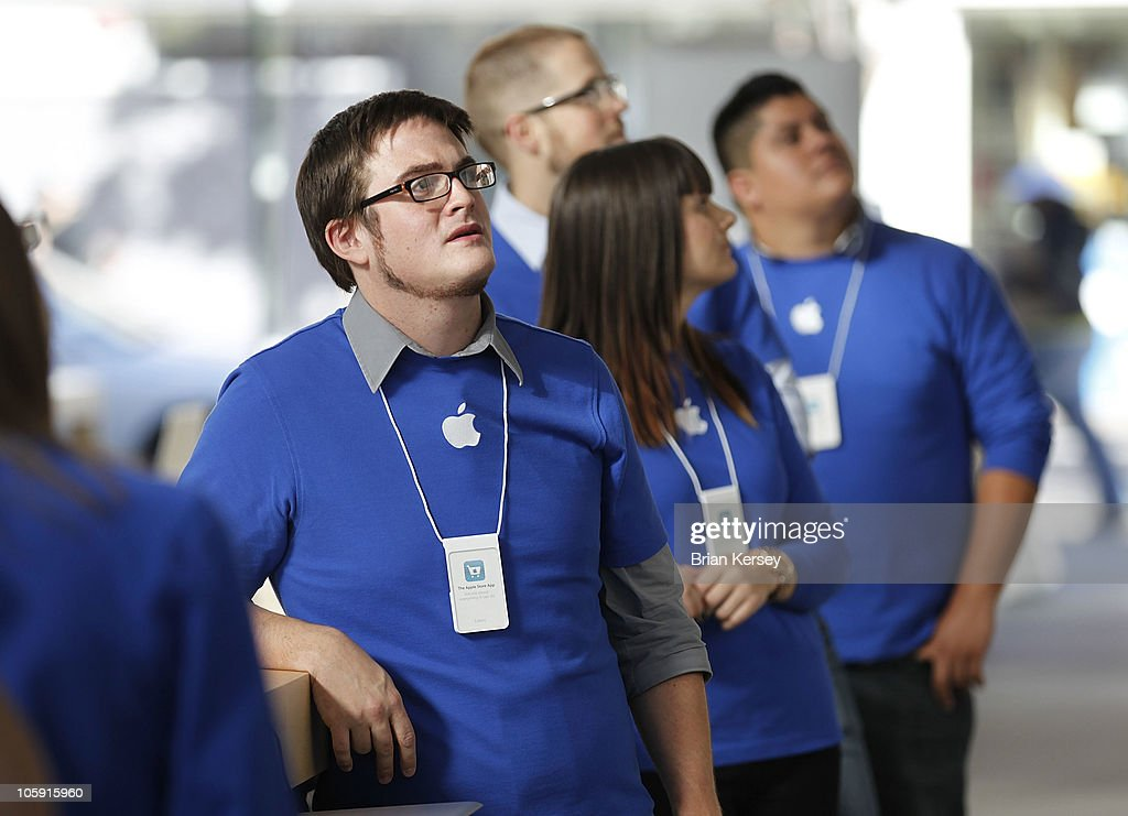 Apple emloyee Louis Weinstein watches a video during a presentation at the new Apple Store on October 21, 2010 in Chicago, Illinois. The new store opens on October 23 in Lincoln Park, a part of the city's Near North Side that has been trendy for several years.