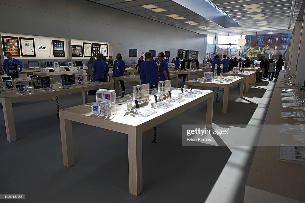 Apple emloyees and media wander the new Apple Store during a media preview on October 21, 2010 in Chicago, Illinois. The new store opens on October 23 in Lincoln Park, a part of the city's Near North Side that has been trendy for several years.