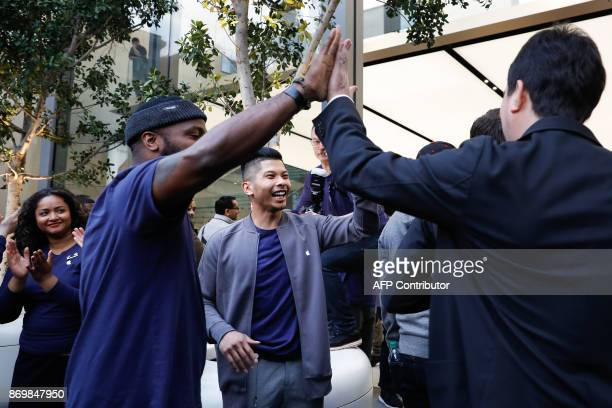 Apple employees greet customers as they enter the store to purchase the iPhone X at the Apple Store Union Square on November 3 in San Francisco...