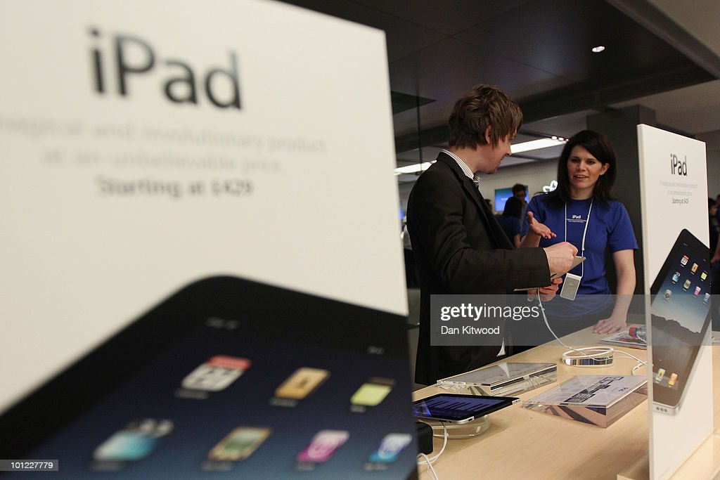 Apple employees help customers with the new iPad on the shop floor at Regent Street's Apple store on May 28, 2010 in London, England. Apple iPads went on sale today in countries including Japan, Australia, Germany, Italy, Canada, Switzerland and the United Kingdom as part of Apple's global roll-out of the hugely successful new device.