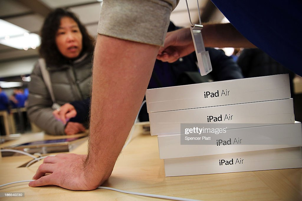 Apple employees sell the new iPad Air at the Apple Store on November 1, 2013 in New York City. The new iPad, which will also come in a mini version and is the fifth generation of the popular tablet, is 20% thinner and 28% lighter than the current fourth-generation iPad. It has the same 9.7-inch screen as previous iPads and uses the same A7 processing chip that's in the iPhone 5S. The iPad Air, which went on sale today, will start at $499 for a 16GB Wi-Fi-only model and go up to $629 for a 16GB with 4G LTE connectivity.