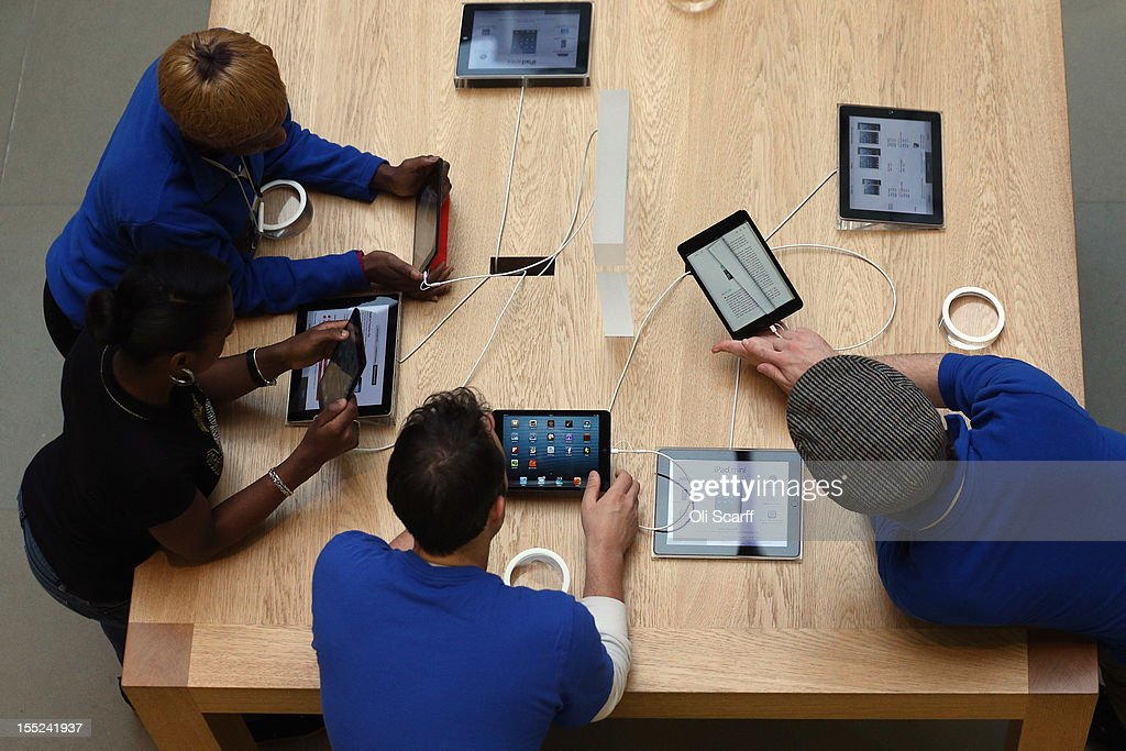Apple employees use demonstration models of the new 'iPad mini' on the morning of the tablet's launch in the Apple Store in Covent Garden on November 2, 2012 in London, England. Customers have queued outside Apple Store branches around the world to be some of the first people to purchase the new smaller iPad tablet computer; the screen on which measures 7.9 inches diagonally compared to 9.7 inches for a regular iPad.