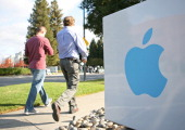 Apple employees walk towards the Apple Headquarters to attend Apple cofounder Steve Jobs' memorial service in Cupertino California on October 19 2011...