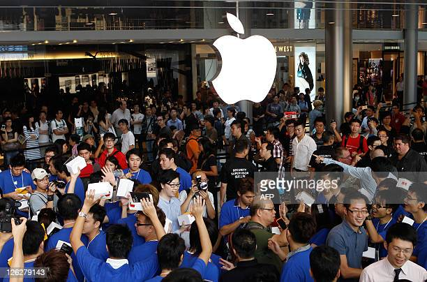 Apple employees welcome customers during the opening of the first Apple retail store in Hong Kong on September 24 2011 Apple opened its first store...