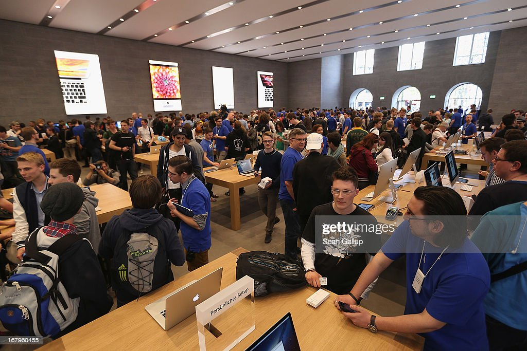 Apple enthusiasts and Apple employees throng the new Apple Store on Kurfuerstendamm avenue on its opening day on May 3, 2013 in Berlin, Germany. Thousands of people waited to enter the store, which is Apple's first in Berlin and its biggest in Germany.