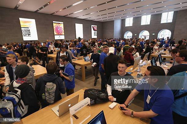 Apple enthusiasts and Apple employees throng the new Apple Store on Kurfuerstendamm avenue on its opening day on May 3 2013 in Berlin Germany...