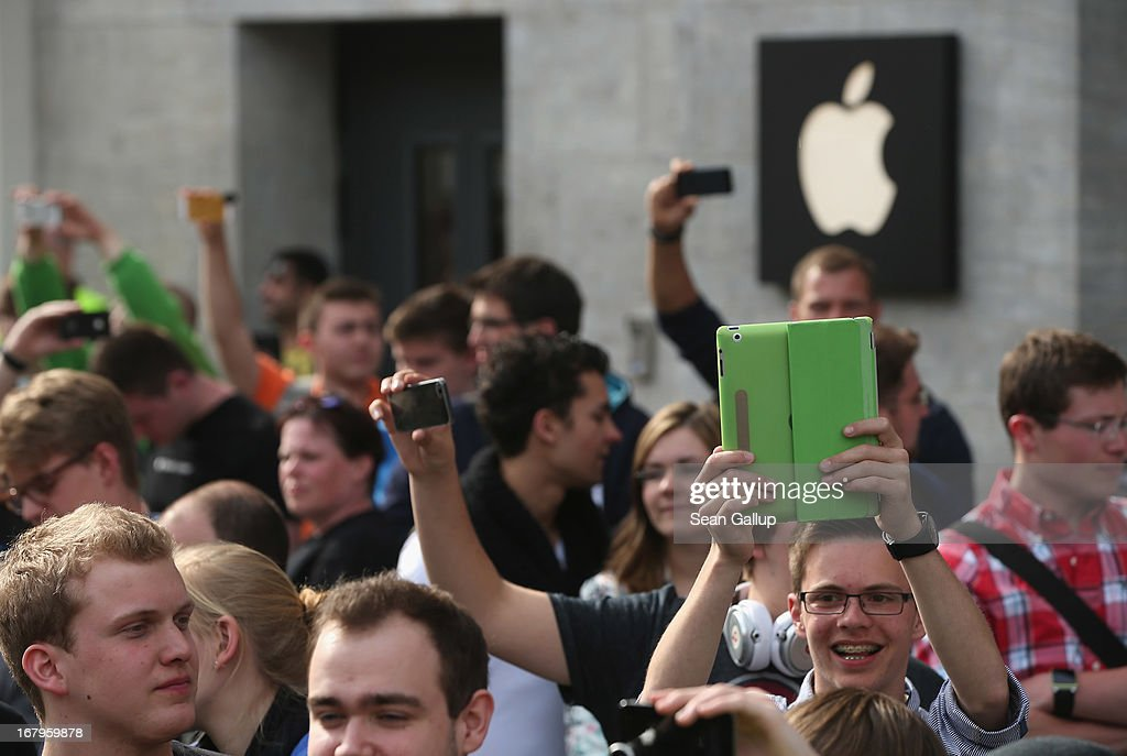 Apple enthusiasts wait in line before entering the new Apple Store on Kurfuerstendamm avenue on its opening day on May 3, 2013 in Berlin, Germany. Thousands of people waited to enter the store, which is Apple's first in Berlin and its biggest in Germany.