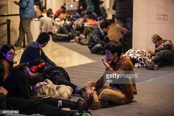 Apple fans wait outside the largest Apple Store in Asia for its opening on January 23 2015 in Hangzhou Zhejiang province of China The Apple Store...