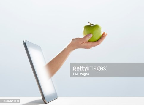 Apple handed out of digital tablet : Stock Photo