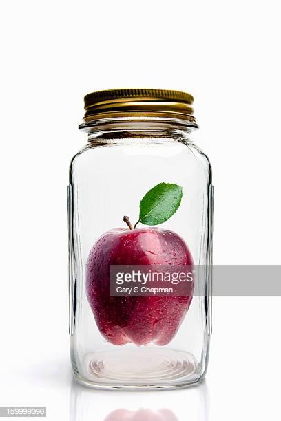 Apple in glass mason jar