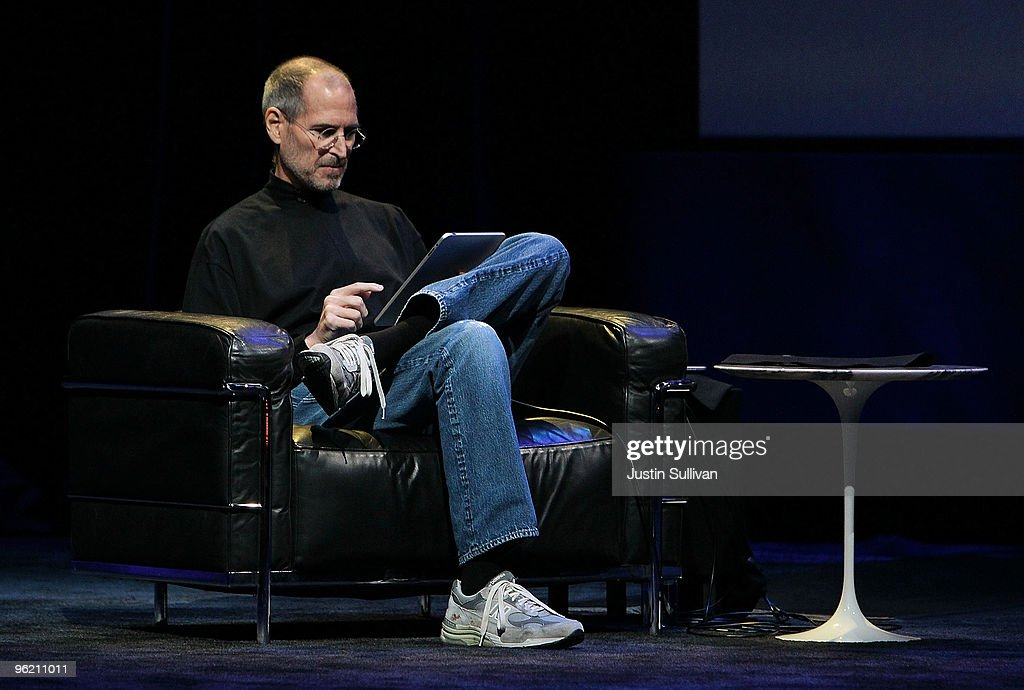 Apple Inc. CEO <a gi-track='captionPersonalityLinkClicked' href=/galleries/search?phrase=Steve+Jobs&family=editorial&specificpeople=204493 ng-click='$event.stopPropagation()'>Steve Jobs</a> demonstrates the new iPad as he speaks during an Apple Special Event at Yerba Buena Center for the Arts January 27, 2010 in San Francisco, California. Apple introduced its latest creation, the iPad, a mobile tablet browsing device that is a cross between the iPhone and a MacBook laptop.