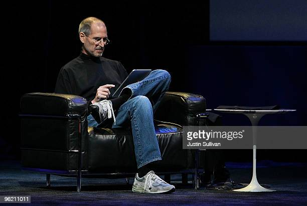 Apple Inc CEO Steve Jobs demonstrates the new iPad as he speaks during an Apple Special Event at Yerba Buena Center for the Arts January 27 2010 in...