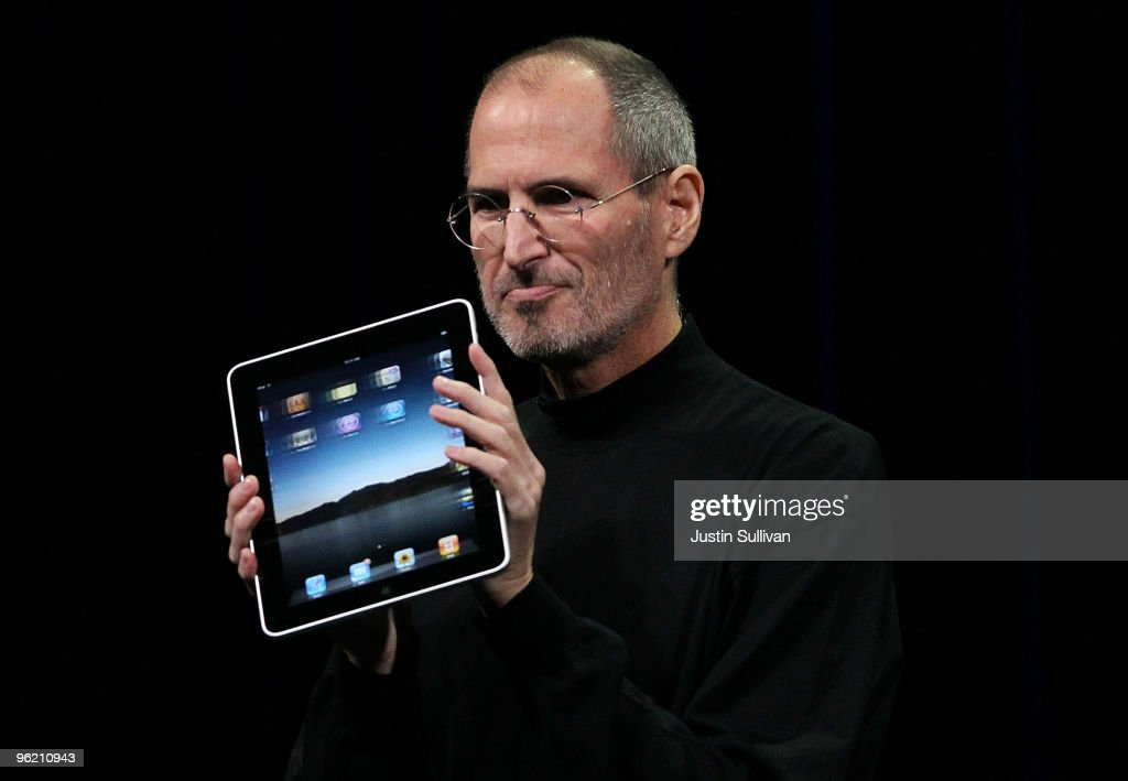 Apple Inc. CEO <a gi-track='captionPersonalityLinkClicked' href=/galleries/search?phrase=Steve+Jobs&family=editorial&specificpeople=204493 ng-click='$event.stopPropagation()'>Steve Jobs</a> holds up the new iPad as he speaks during an Apple Special Event at Yerba Buena Center for the Arts January 27, 2010 in San Francisco, California. Apple introduced its latest creation, the iPad, a mobile tablet browsing device that is a cross between the iPhone and a MacBook laptop.