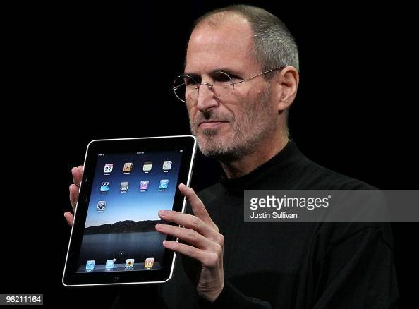 Apple Inc CEO Steve Jobs holds up the new iPad as he speaks during an Apple Special Event at Yerba Buena Center for the Arts January 27 2010 in San...
