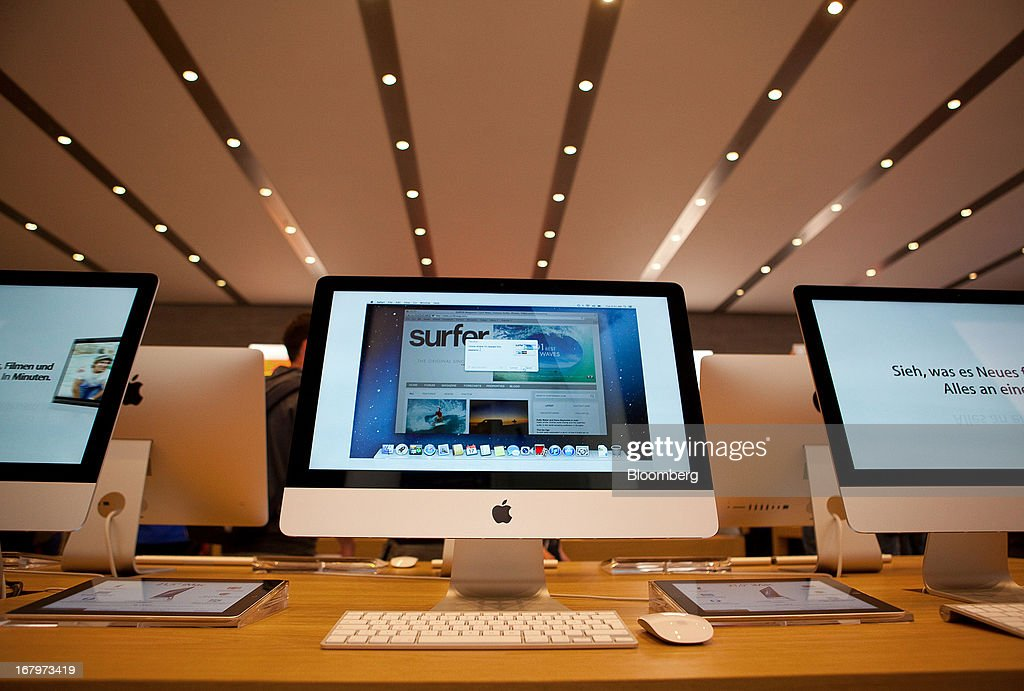 Apple Inc. iMac computers are seen on display at the new Apple Inc. store located on Kurfurstendamm Street in Berlin, Germany, on Friday, May 3, 2013. Apple Inc.'s latest showcase store, their first in the German capital city will open its doors to the public today. Photographer: Krisztian Bocsi/Bloomberg via Getty Images