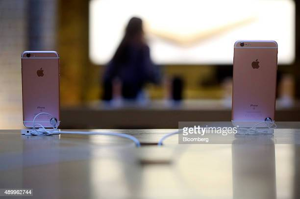 Apple Inc iPhone 6S smartphone devices in rose gold sit on display at the Apple Inc store at Covent Garden in London UK on Friday Sept 25 2015 The...