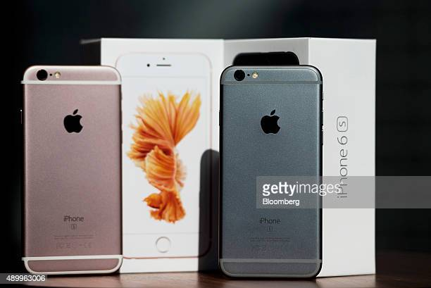 Apple Inc iPhone 6s smartphones stand next to packaging boxes in an arranged photograph in Hong Kong China on Friday Sept 25 2015 The latest models...