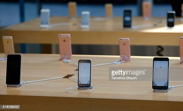 Apple Inc iPhones including iPhone SE center front are displayed at the company's Omotesando store on March 31 2016 in Tokyo Japan Apple Inc launched...