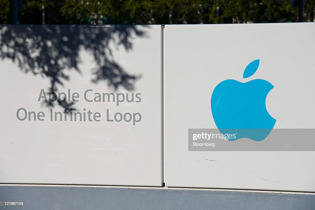 Apple Inc. signage is seen outside the company's headquarters in Cupertino, California, U.S., on Wednesday, Aug. 24, 2011. Apple Inc. chief executive officer Steve Jobs, who transformed the company he started at age 21 from a personal-computer also-ran into the world's largest technology company, resigned today. Photographer: David Paul Morris/Bloomberg via Getty Images