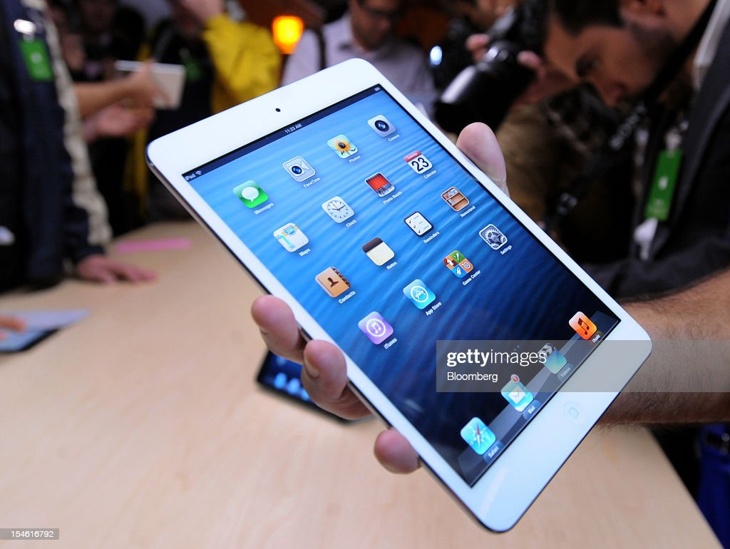 Apple Inc.'s iPad Mini is held for a photograph during an Apple launch event in San Jose, California, U.S., on Tuesday, Oct. 23, 2012. Apple Inc. introduced a smaller version of the iPad designed to keep customers from buying low-cost tablets from competitors Microsoft Corp., Amazon.com Inc. and Google Inc. Photographer: Noah Berger/Bloomberg via Getty Images