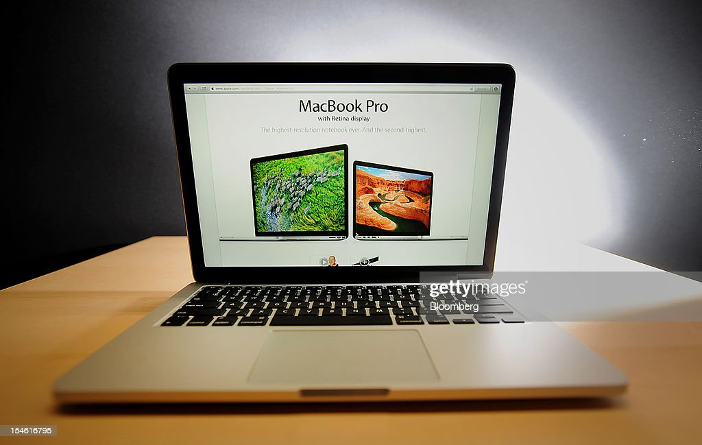 Apple Inc.'s MacBook Pro is displayed for the media during an Apple launch event in San Jose, California, U.S., on Tuesday, Oct. 23, 2012. Apple Inc. introduced a 13-inch MacBook Pro with a high-definition display and thinner profile, as the company adds more features to its line of computer notebooks. Photographer: Noah Berger/Bloomberg via Getty Images