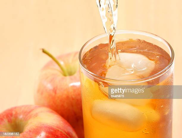 Apple juice being poured into a glass