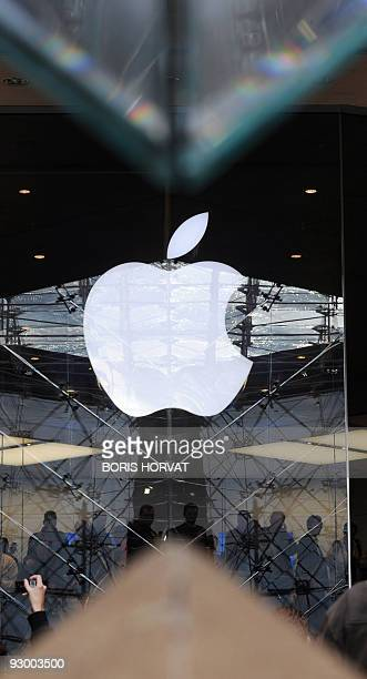 Apple logo reflects on a glass of Louvre museum on November 7 2009 on the opening day of France's first US technology Apple Store inside the...