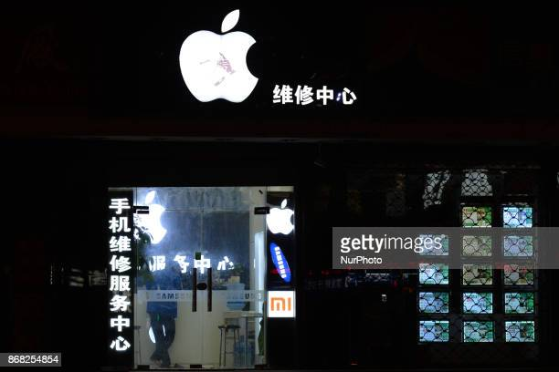 Apple logo seen in Shanghai city center on the day when Apple's CEO Cook Facebook's CEO Zuckerberg meet China's Xi in Beijing On Monday 30 October...