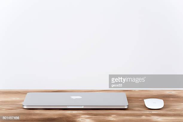 Apple MacBook Pro.with Apple magic mouse 2 on table.
