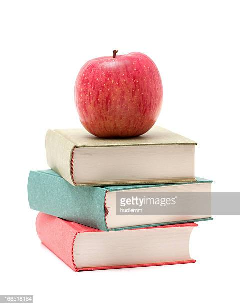 Apple on a Stack of Book isolated on white background