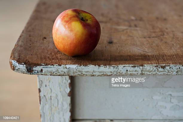 Apple on the egde of table