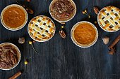 Overhead view of three mini  pies - apple pie pumpkin pie and pecan pie / Thanksgiving Desserts