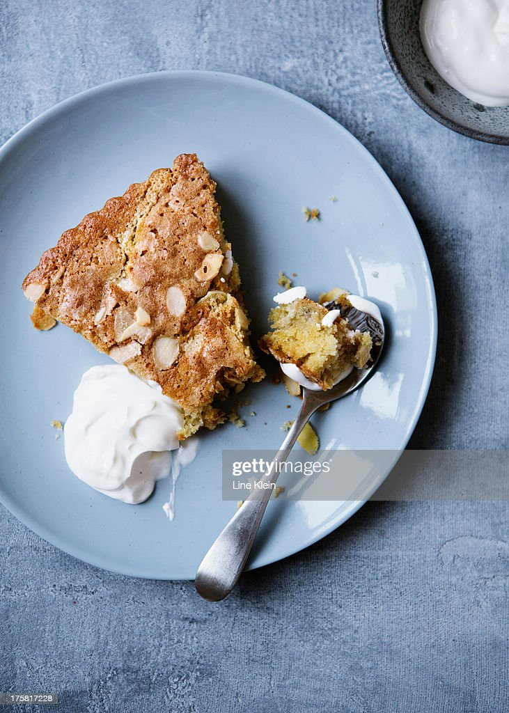 Apple pie with almond flakes and creme fraiche : Stock Photo
