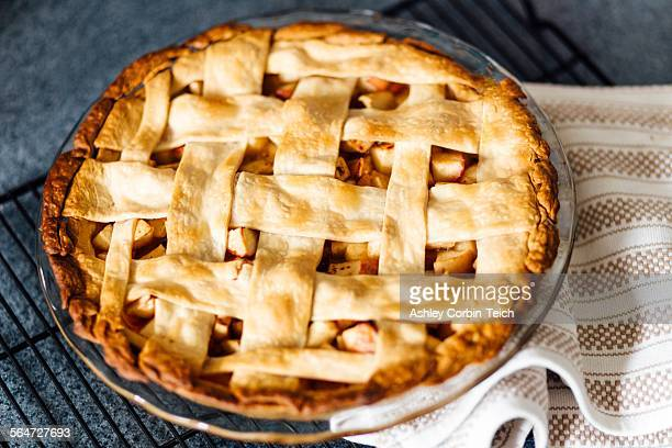 Apple pie with latticed pastry on kitchen counter