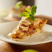 close up photo of an apple pie with mint garnish