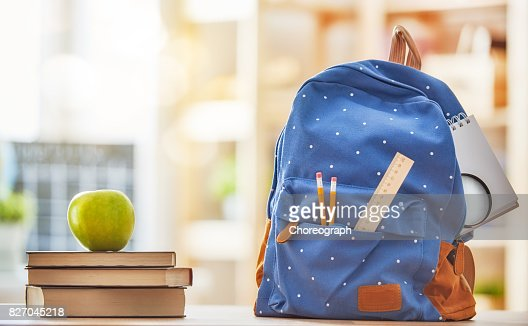 Apple, pile of books and pencils : Stock Photo