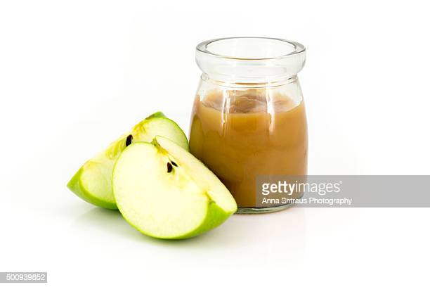 Apple Sauce in a Jar with Apple Half on a White Background