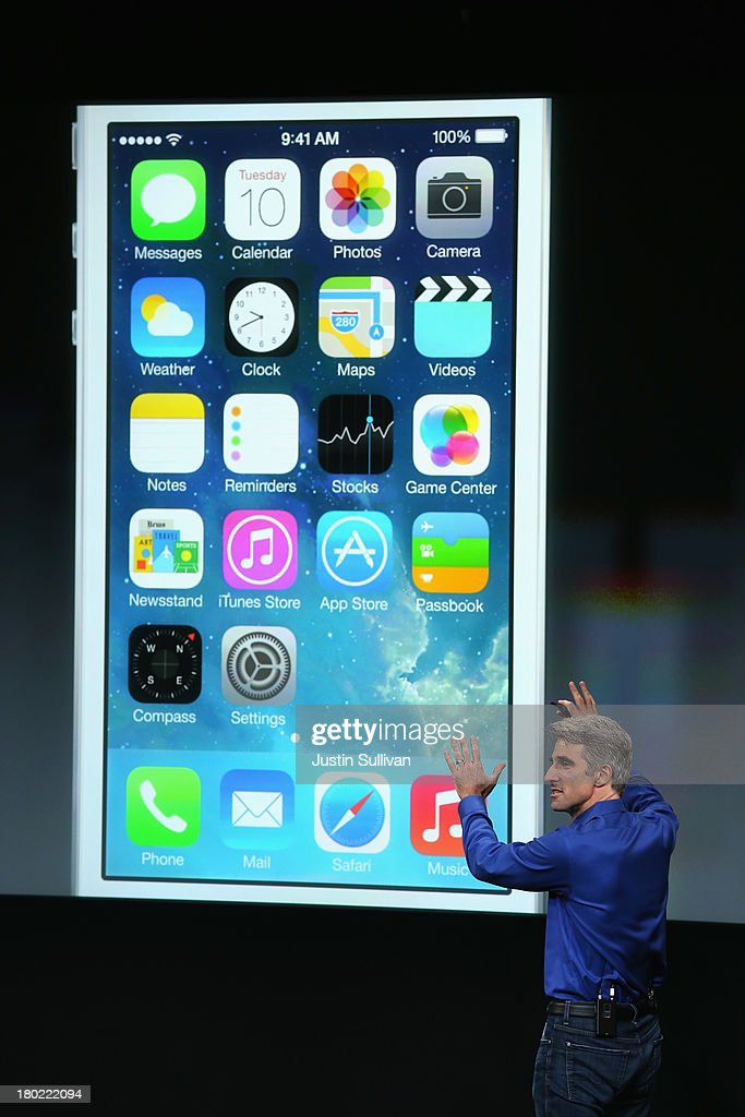 Apple Senior Vice President of Software Engineering Craig Federighi speaks about iOS 7 on stage during an Apple product announcement at the Apple campus on September 10, 2013 in Cupertino, California. The company is expected to launch at least one new iPhone model.