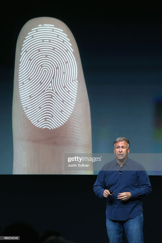 Apple Senior Vice President of Worldwide Marketing <a gi-track='captionPersonalityLinkClicked' href=/galleries/search?phrase=Phil+Schiller&family=editorial&specificpeople=1384861 ng-click='$event.stopPropagation()'>Phil Schiller</a> speaks about security features of the new iPhone 5S during an Apple product announcement at the Apple campus on September 10, 2013 in Cupertino, California. The company launched two new iPhone models that will run iOS 7. The 5C is made from a hard-coated polycarbonate and comes in five colors. The 5S features a fingerprint sensor, has an upgraded camera, and contains an A7 chip