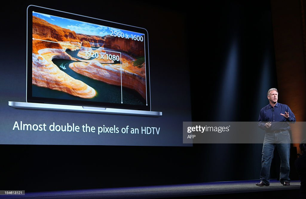 Apple Senior Vice President of Worldwide Marketing Phil Schiller announces the new 13inch Macbook Pro with a Retina Display during Apple's special event at the California Theatre in San Jose, California on October 23, 2012. Anticipation built Tuesday as Apple prepared to unwrap its 'iPad Mini,' launching a foray into the crowded market of smaller tablet computers dominated by Amazon, Google, and Samsung. AFP Photo/ Kimihiro Hoshino