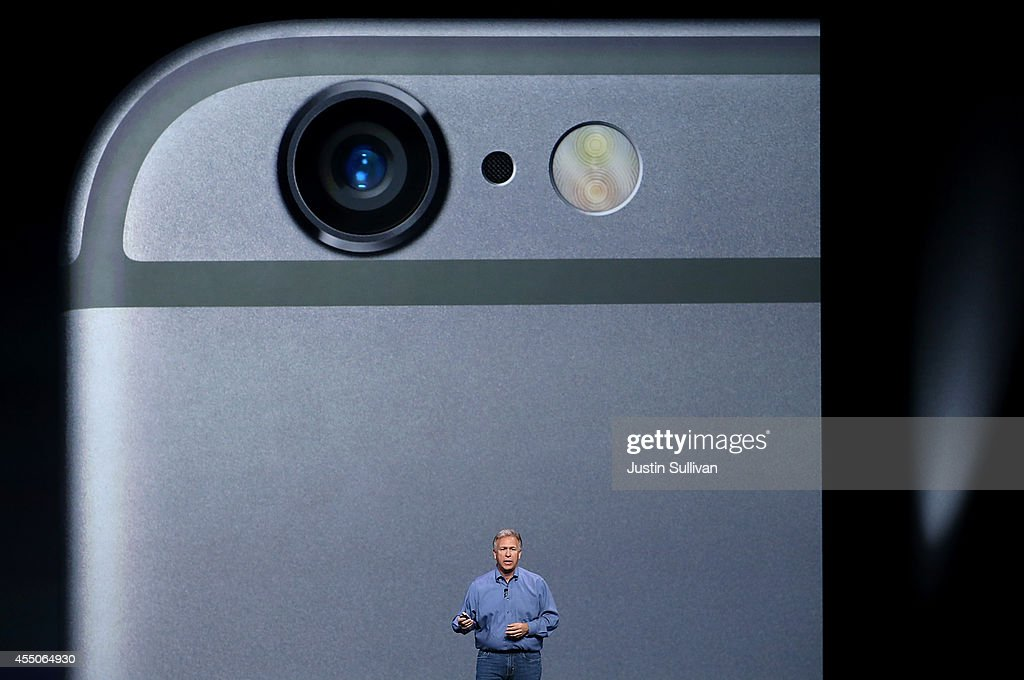Apple Senior Vice President of Worldwide Marketing <a gi-track='captionPersonalityLinkClicked' href=/galleries/search?phrase=Phil+Schiller&family=editorial&specificpeople=1384861 ng-click='$event.stopPropagation()'>Phil Schiller</a> announcees the new iPhone 6 during an Apple special event at the Flint Center for the Performing Arts on September 9, 2014 in Cupertino, California. Apple is expected to unveil the new iPhone 6.