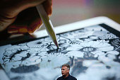 Apple senior vice president of worldwide marketing Phil Schiller announces the new 97' iPad pro during an Apple special event at the Apple...