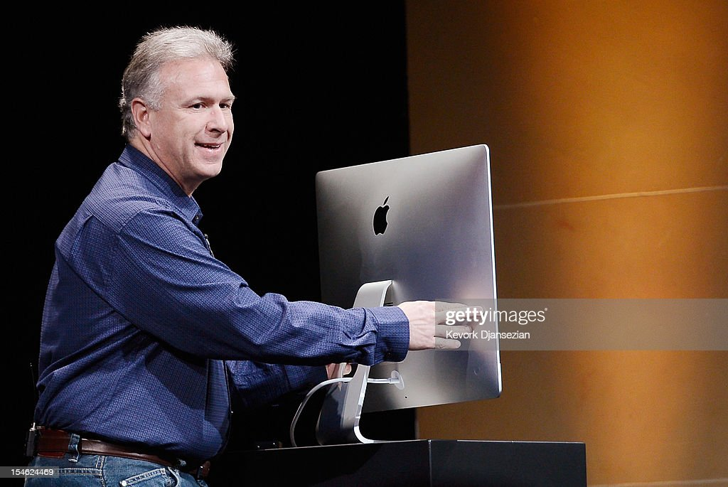 Apple Senior Vice President of Worldwide product marketing <a gi-track='captionPersonalityLinkClicked' href=/galleries/search?phrase=Phil+Schiller&family=editorial&specificpeople=1384861 ng-click='$event.stopPropagation()'>Phil Schiller</a> shows a a thinner new iMac desktop computer during an Apple special event at the historic California Theater on October 23, 2012 in San Jose, California. Apple introduced the new iPad mini at the event, Apple's smaller 7.9 inch version of the iPad tablet.
