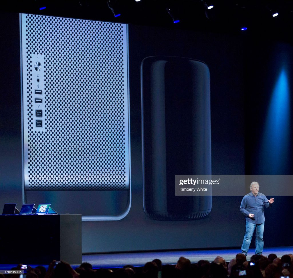 Apple Senior Vice President of Worldwide product marketing Phil Schiller stands in front of a screen displaying the new Mac Pro (R) next to the older version during the 2013 Apple Apple Worldwide Developers Conference at the Moscone Center on June 10, 2013 in San Francisco, California. Apple introduced a new mobile operatng system iOS 7, hardware upgrades and a new operating system OS X Mavericks during the keynote qaddress. The annual developer conference runs through June 14.