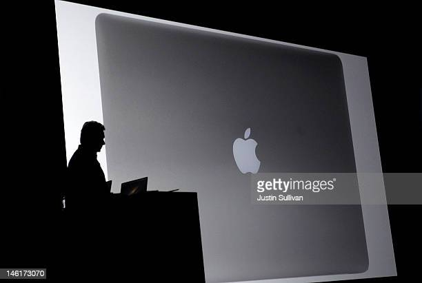 Apple Senior Vice President of Worldwide product marketing Phil Schiller announces the new MacBook Pro during the keynote address at the Apple 2012...